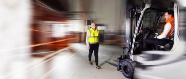Man with safety vest in the warehouse